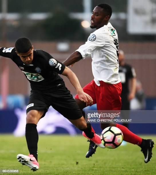 Guingamp's defender Fernando Marcal De Oliveira vies with FrejusSaint Raphael's defender Evander Moreira during the French Cup final quarter football...