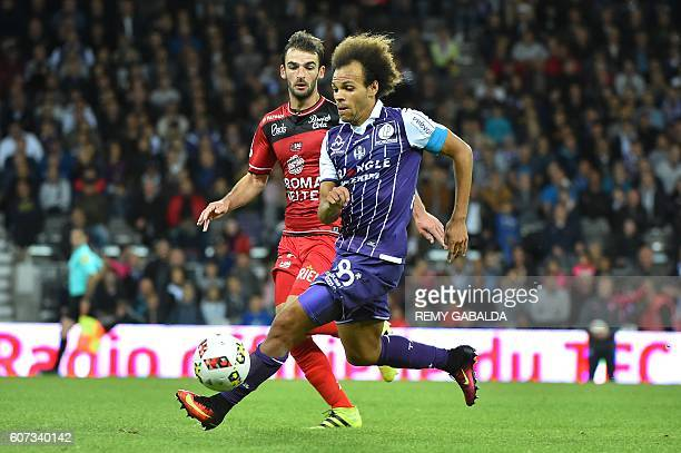 Guingamp's defender Mustapha Diallo vies with Toulouse's captain Martin Braithwaith during the French L1 football match Toulouse against Guingamp on...