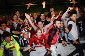 Guingamp's fans celebrate their team's victory after the French L2 football match Ajaccio vs Guingamp on May 17 2013 at the Jean Laville stadium in...