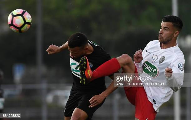 Guingamp's Fernando Marcal De Oliveira vies with FrejusSaint Raphael's forward Karim Tlili during the French Cup final quarter football match between...