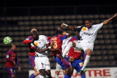 Guingamp's forward Christophe Mandanne jumps for the ball during the French L2 football match Ajaccio vs Guingamp on May 17 2013 at the Jean Laville...
