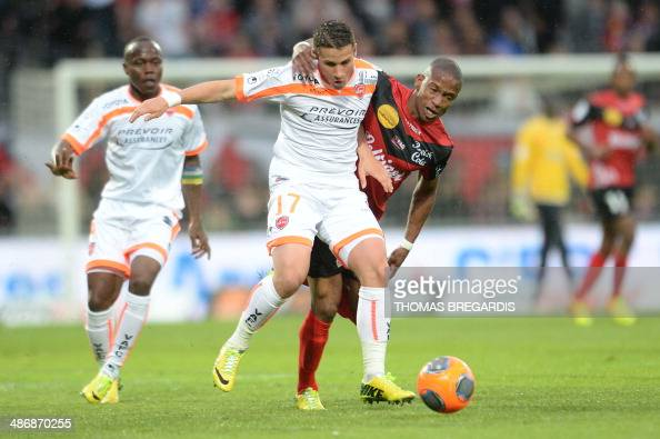 Guingamp's forward Claudio Beauvue vies with Valenciennes' defender Loris Nery during the French L1 football match between Guingamp and Valenciennes...