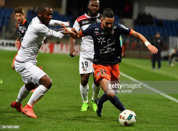 Guingamp's FranchCongolese defender Jordan Ikoko vies with Montpellier's French midfielder Ryad Boudebouz during the French L1 football match between...