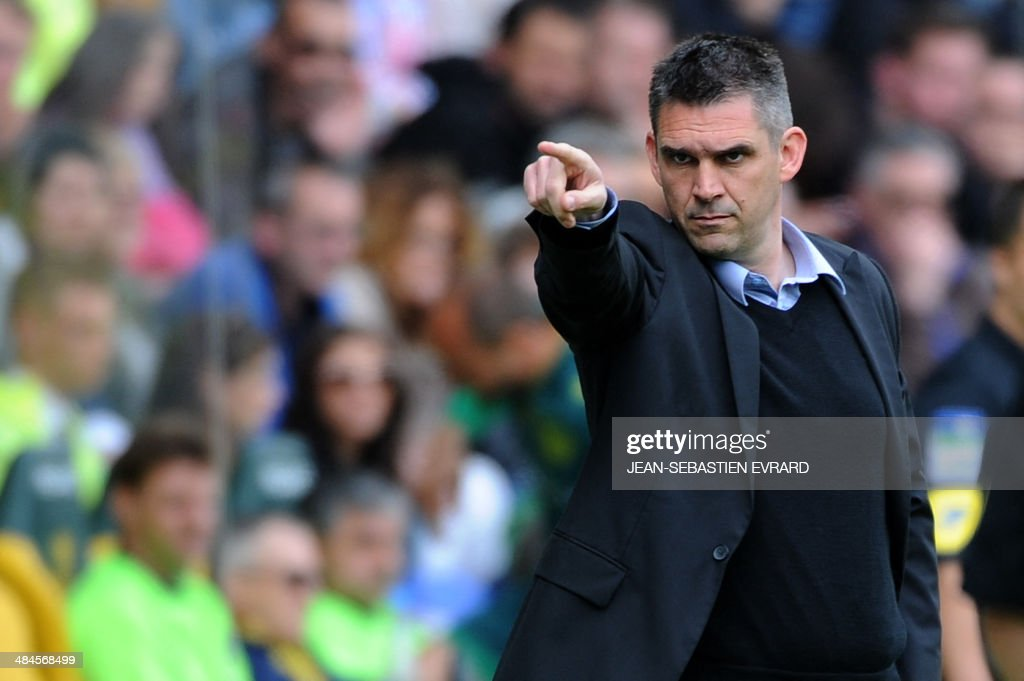 Guingamp's French coach Jocelyn Gourvennec gestures during the French L1 football match between Nantes and Guingamp on April 13, 2014 at the Beaujoire stadium in Nantes, western France.