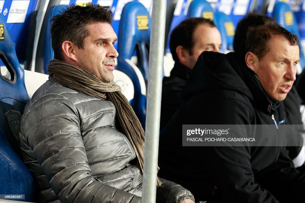 Guingamp's French coach Jocelyn Gourvennec (L) is seated on the bench during the French L1 football match Bastia (SCB) against Guingamp (AEG) in the Armand Cesari stadium in Bastia, in the French Mediterranean Island of Corsica, on February 1 , 2014.