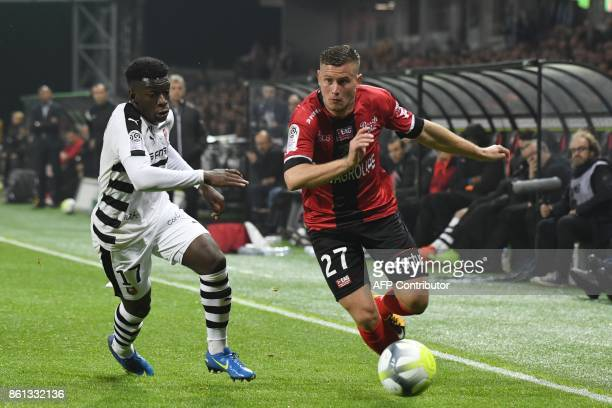 Guingamp's French defender Franck Tabanou vies with Rennes' French midfielder Faitout Maouassa during the French Ligue 1 football match Guingamp...