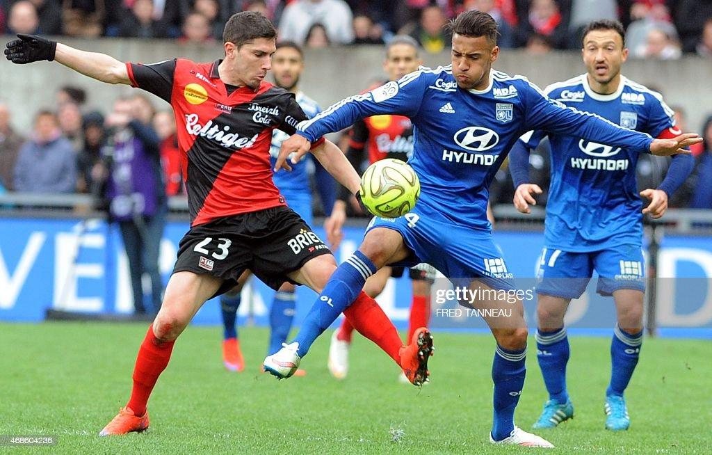 Guingamp's French defender Jeremy Pied (L) vies with Lyon's French midfielder Corentin Tolisso during the French L1 football match between Guingamp and Lyon on April 4, 2015 at the Roudourou stadium in Guingamp, western of France.