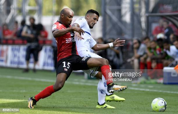 Guingamp's French defender Jeremy Sorbon fights for the ball with Strasbourg's French forward Idriss Saadi during the French Ligue 1 football match...