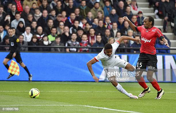 Guingamp's French defender Jeremy Sorbon fools Paris SaintGermain's midfielder Christopher Alan Nkunku and gives Paris a penalty kick during the...