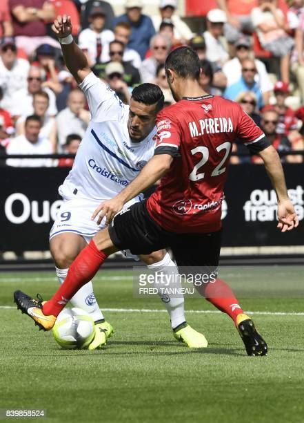 Guingamp's French defender Jonathan Martins Pereira and Strasbourg's French forward Idriss Saadi fight for the ball during the French Ligue 1...
