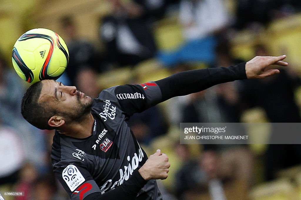Guingamp's French defender Jonathan Martins Pereira heads the ball during the French L1 football match between Monaco (ASM) and Guingamp (EADG) on April 30, 2016, at the Louis II stadium in Monaco.