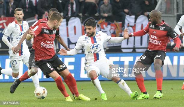 Guingamp's French defender Lucas Deaux and Guingamp's French forward Yannis Salibur vie with Lyon's French midfielder Nabil Fekir during the French...