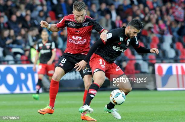Guingamp's French defender Lucas Deaux vies with Dijon's FrenchAlgerian midfielder Mehdi Abeid during the French L1 football match between Guingamp...