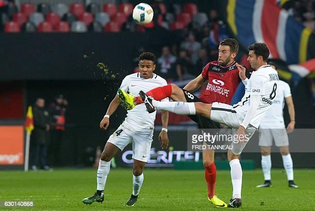 Guingamp's French defender Lucas Deaux vies with Paris SaintGermain's French midfielder Christopher Nkunku and Paris SaintGermain's Italian...