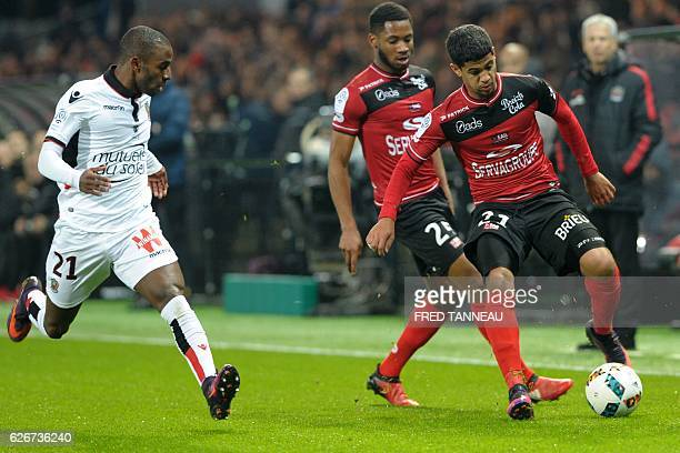 Guingamp's French defender Ludovic Blas and Guingamp's French defender Marcus Coco vie with Nice's Portuguese defender Ricardo Pereira during the...