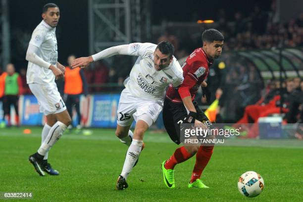 Guingamp's French defender Ludovic Blas vies with Caen's French midfielder Julien Feret during the French L1 football match Guingamp against Caen on...