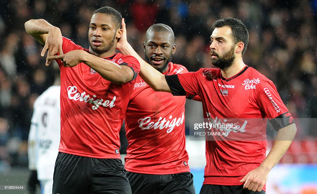 Guingamp's French defender Marcus Coco (L) celebrates after scoring a goal during the French L1 football match Guingamp against Bordeaux on February 13, 2016 at the Roudourou stadium in Guingamp, western France. / AFP / FRED TANNEAU
