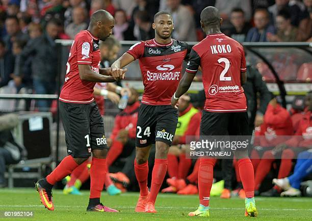 Guingamp's French defender Marcus Coco is congratulated by his teammates after scoring a goal during the French L1 football match Guingamp vs...