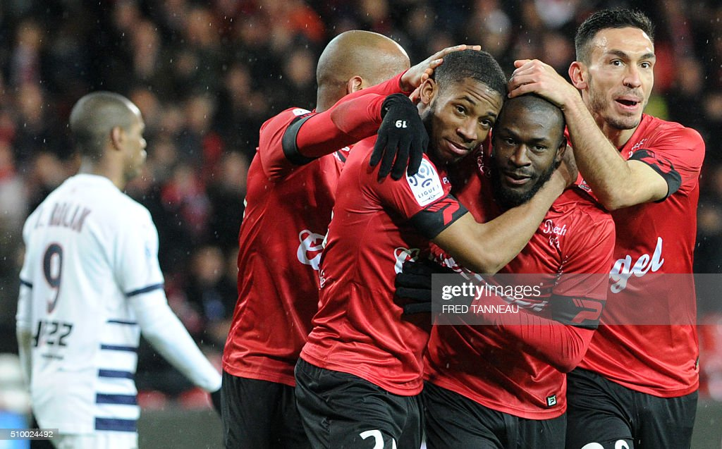 Guingamp's French defender Marcus Coco (2ndL) is congratulated by teammates after scoring a goal during the French L1 football match Guingamp against Bordeaux on February 13, 2016 at the Roudourou stadium in Guingamp, western France. / AFP / FRED TANNEAU