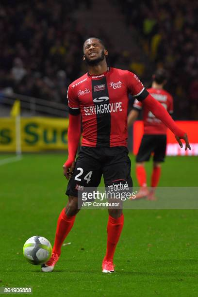 Guingamp's French defender Marcus Coco reacts during the French L1 football match Nantes vs Guingamps at the La Beaujoire stadium in Nantes western...