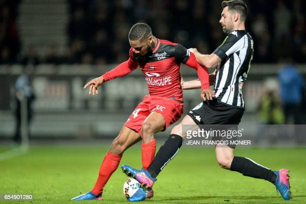 Guingamp's French defender Marcus Coco vies with Angers' French midfielder Thomas Mangani during the French L1 football match between Angers and...
