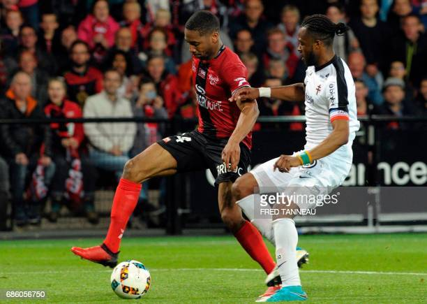 Guingamp's French defender Marcus Coco vies with Metz's Cameroonian midfielder Georges Mandjeck during the French L1 football match EAG Guingamp...