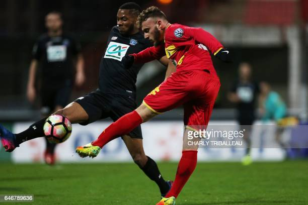 Guingamp's French defender Marcus Coco vies with Quevilly Rouen's French midfielder Anthony Rogie during the French Cup football match between...