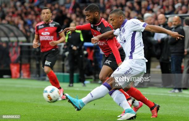 Guingamp's French defender Marcus Coco vies with Toulouse's French defender Kelvin Amian during the French L1 football match Guingamp versus Toulouse...