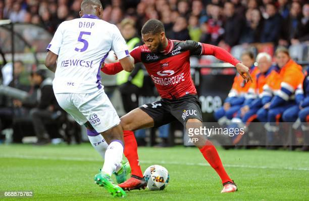 Guingamp's French defender Marcus Coco vies with Toulouse's French defender Issa Diop during the French Ligue 1 football match Guingamp vs Toulouse...