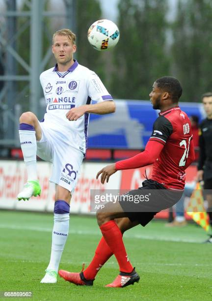 Guingamp's French defender Marcus Coco vies with Toulouse's Sewdish forward Ola Toivonen during the French L1 football match between Guingamp and...
