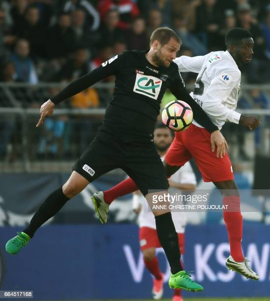 Guingamp's French defender Mathieu Bodmer vies with FrejusSaint Raphaël's Neupoc Mendy during the French Cup final quarter football match between...