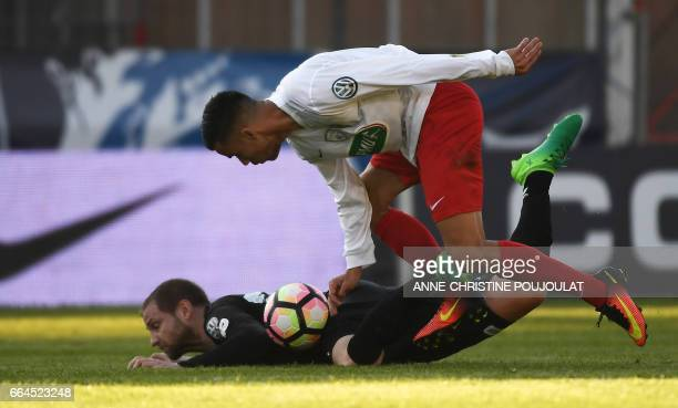 Guingamp's French defender Mathieu Bodmer vies with FrejusSaint Raphaël's forward Karim Tlili during the French Cup final quarter football match...