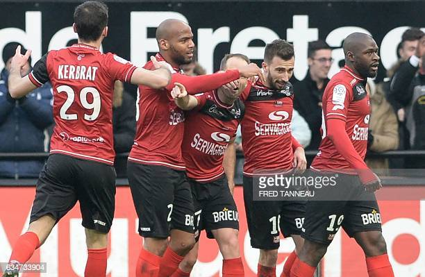 Guingamp's French defender Nicolas Benezet celebrates with his teammates after scoring a goal during the French Ligue 1 football match between...