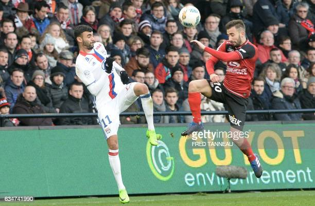 Guingamp's French defender Nicolas Benezet vies with Lyon's French Algerian midfielder Rachid Ghezzal during the French Ligue 1 football match...