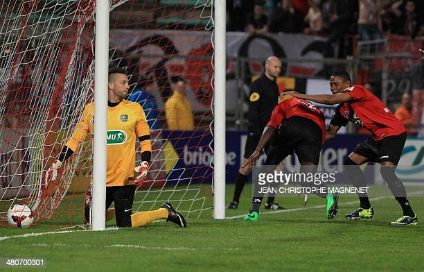 Guingamp's French forward Christophe Mandanne congratulates Guingamp's French forward Mustapha Yatabare after he scored a goal during the French Cup...