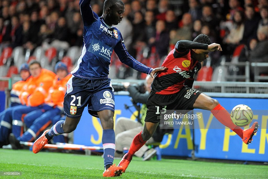 Guingamp's French forward Christophe Mandanne (R) vies with Evian's Congolese defender <a gi-track='captionPersonalityLinkClicked' href=/galleries/search?phrase=Cedric+Mongongu&family=editorial&specificpeople=4305033 ng-click='$event.stopPropagation()'>Cedric Mongongu</a> during the French L1 football match between Guingamp and Evian on April 18, 2015 at the Roudourou stadium in Guingamp, western of France. AFP PHOTO / FRED TANNEAU