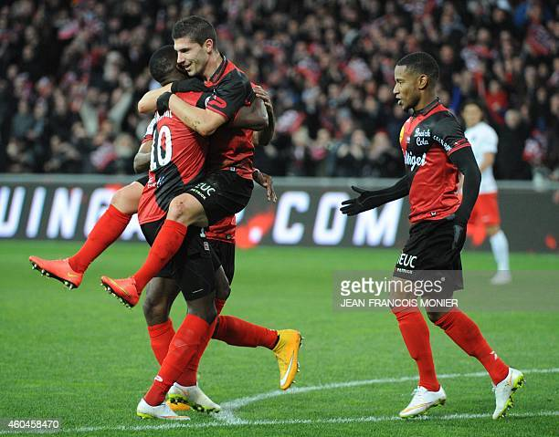Guingamp's French forward Jeremy Pied celebrates with teammates after scoring during the French L1 football match between EA Guingamp and Paris...