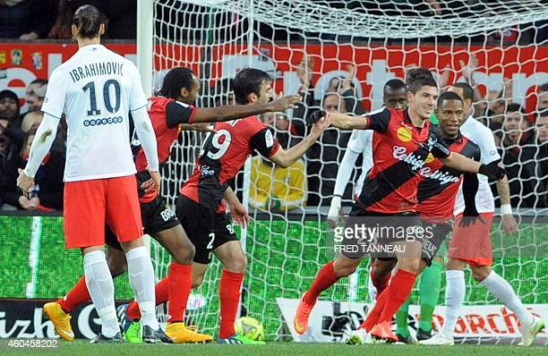 Guingamp's French forward Jeremy Pied jubilates after scoring during the French L1 football match Guingamp versus Paris SaintGermain on December 14...