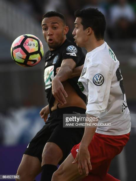 Guingamp's French forward Jimmy Briand vies with FrejusSaint Raphael's Fabien Dao Castellana during the French Cup final quarter football match...