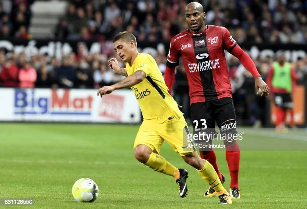 Guingamp's French forward Jimmy Briand vies with Paris SaintGermain's Italian midfielder Marco Verratti during the French L1 football match Guingamp...
