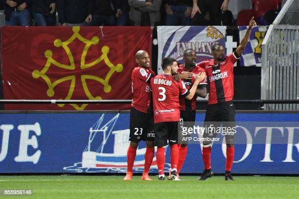 Guingamp's French forward Marcus Thuram celebrates with Guingamp's Senegalese midfielder Moustapha Diallo after scoring a goal during the French L1...