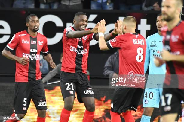 Guingamp's French forward Marcus Thuram celebrates with Guingamp's French midfielder Lucas Deaux after scoring a goal during the French L1 football...