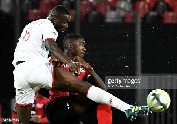Guingamp's French forward Marcus Thuram vies with Lille's French defender Ibrahim Amadou during the French L1 football match between Guingamp and...
