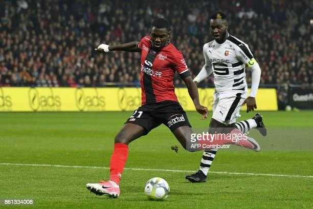 Guingamp's French forward Marcus Thuram vies with Rennes' French defender Joris Gnagnon during the French Ligue 1 football match Guingamp against...