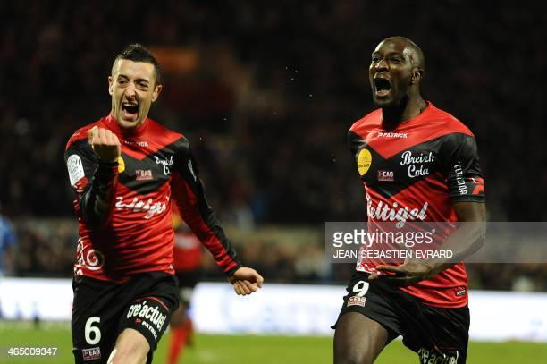 Guingamp's French forward Mustapha Yatabare celebrates with his teammate Guingamp's French defender Jonathan Martins Pereira after scoring during the...