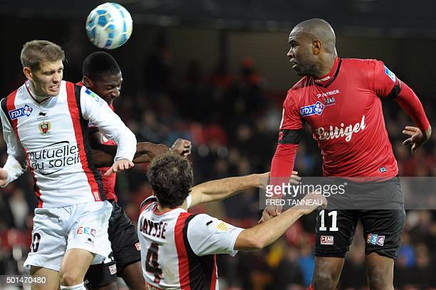 Guingamp's French forward Sloan Privat vies with Nice's French defender Maxime Le Marchand and Nice's French defender Paul Baysse during the French...