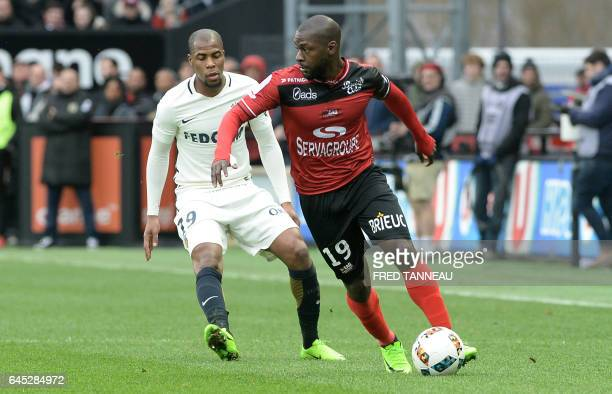 Guingamp's French forward Yannis Salibur outruns Monaco's French defender Djibril Sidibe during the French L1 football match Guingamp vs Monaco on...