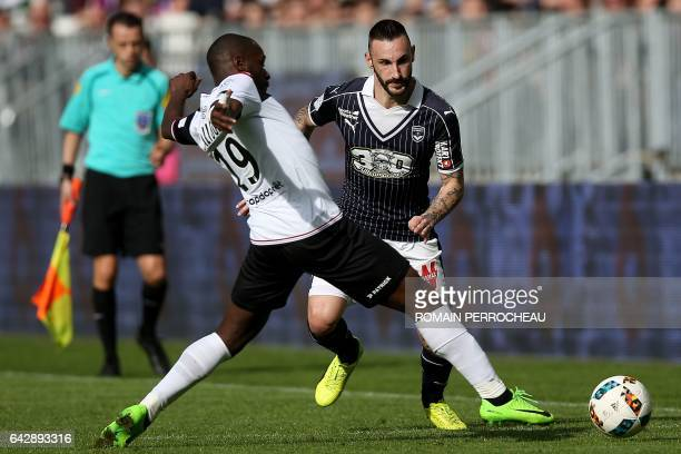 Guingamp's French forward Yannis Salibur vies with Bordeaux's German defender Diego Contento during the French L1 football match between Bordeaux and...