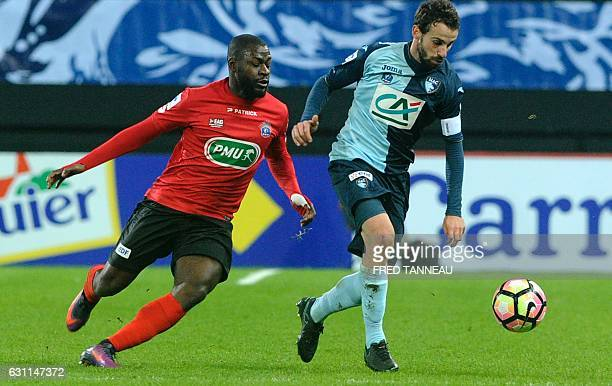 Guingamp's French forward Yannis Salibur vies with Le Havre's French midfielder Alexandre Bonnet during the French Cup football match Guingamp versus...