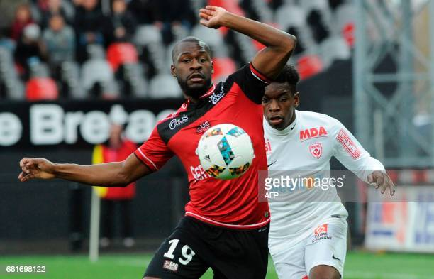 Guingamp's French forward Yannis Salibur vies with Nancy's French defender Faitout Maouassa during the French L1 football match Guingamp against...